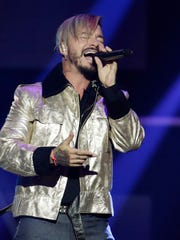 "Singer J Balvin performs during the Latin Billboard Awards in Coral Gables, Fla. J Balvin's song, ""Mi Gente,"" a collaboration with Willy Williams, was a big hit this year."