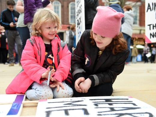 Kaitlyn Russell, 6, left, and Lily Bostick, 6, doodle