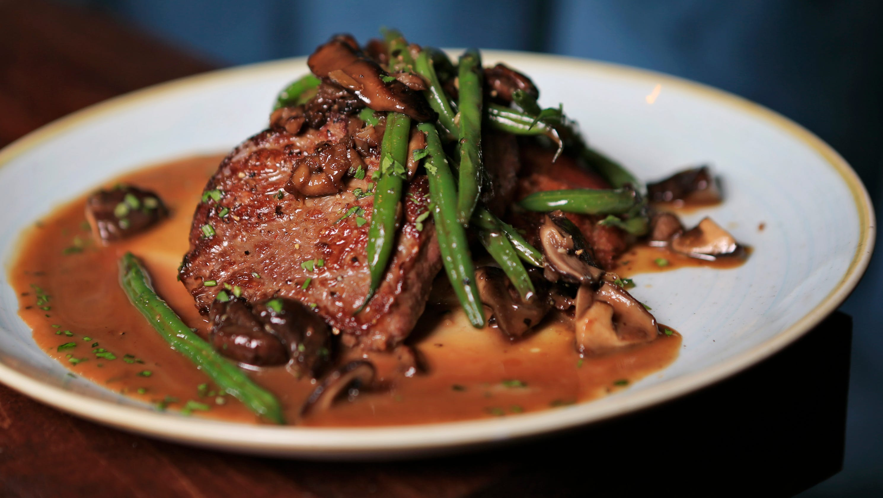 Food network says le moo steakhouse in louisville sizzles for 2b cuisine epsom downs