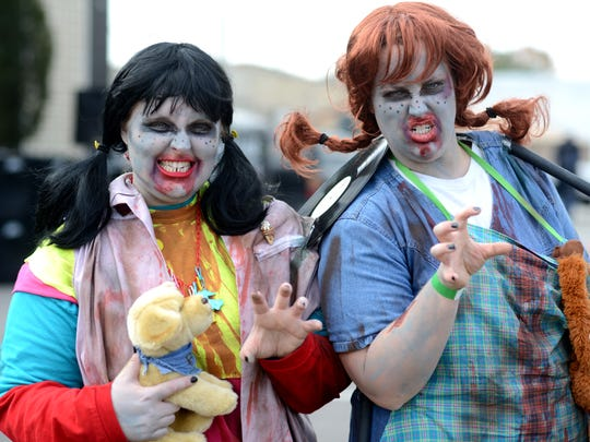 Haley Hensley and Erin Branch dressed as Pippi Longstocking and Punky Brewster for the Milan Zombie Walk Saturday. Walkers were encouraged to bring cans of food for the Feeding America Backpack Program.