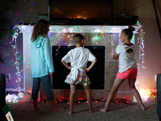 Ryland Kelting, center, comes up with a dance for friends Anna Leigh Anderson, left, and Emma Pitz, both 9, to perform Thursday, June 2, 2016, during his ninth birthday party in Waukee.