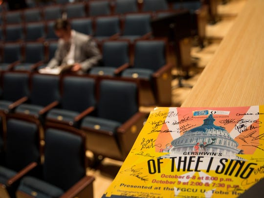 """A stack of signed posters sits in the theater during rehearsals at the Florida Gulf Coast University's Bower School of Music and Arts on Monday, Oct. 3, 2016. TheatreZone and the FGCU drama school are collaborating on the musical """"Of Thee I Sing"""" that won a Pulitzer prize for spearing American politics in song and dance."""