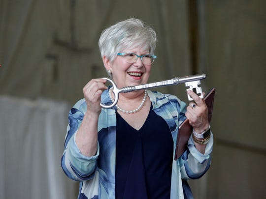 Cyndy Stiehl is presented with a key to the city of Manitowoc during the christening ceremony at the Burger Boat shipyard Monday, June 18, 2018, in Manitowoc, Wis. Josh Clark/USA TODAY NETWORK-Wisconsin