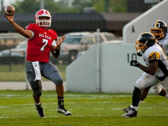 Port Huron's DeAngelo Sanderson throws a pass against Detroit Martin Luther King at Port Huron High School.