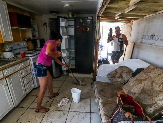 Manuel Ruiz and Alma Gutierrez work feverishly to dry