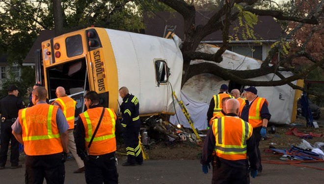 Chattanooga Fire Department personnel work the scene of a fatal elementary school bus crash in Chattanooga, Tenn., Monday, Nov. 21, 2016.