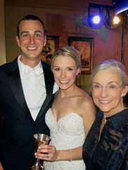 Groom Tyler Daniel and Lila Nelson with her mom Terri