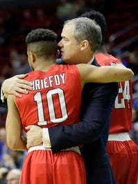 Stony Brook guard Carson Puriefoy (10) gets a hug from coach Steve Pikiell at the end of a first-round NCAA Tournament game vs. Kentucky.