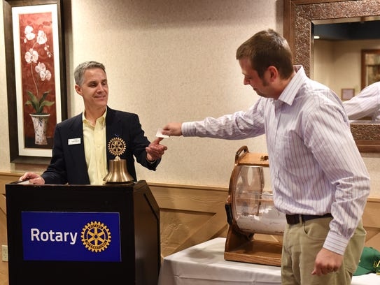 Rotary of Huron Valley president Doug McMunn accepts