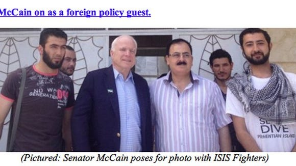 Who is McCain posing with?