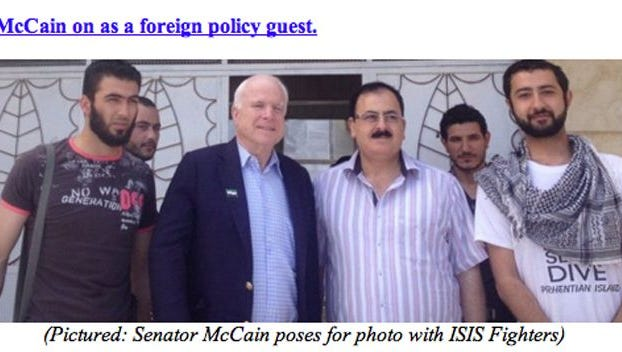 """Sen. John McCain's office is blasting as a fabrication and a """"smear"""" a liberal group's claim that McCain is posing in this photo with terrorist """"ISIS fighters"""" in Syria."""