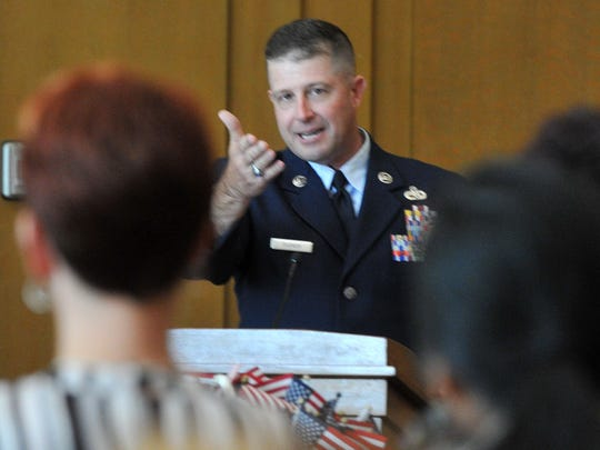 Chief Master Sgt. Eric Dudash from Sheppard Air Force Base talked to a group of newly sworn citizens during a naturalization proceeding in the Federal courtroom Friday afternoon.