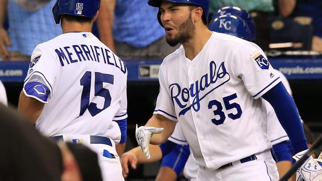 Kansas City Royals' Whit Merrifield (15) is congratulated by Eric Hosmer (35) after his solo home run off Cleveland Indians starting pitcher Carlos Carrasco during the fourth inning Monday night at Kauffman Stadium in Kansas City, Mo.