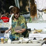 Kat Caillier is looking over some of the stuff available for sale during the Breaux Bridge Garage in 2006.