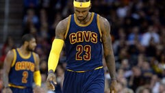 Cavaliers forward LeBron James walks down court during