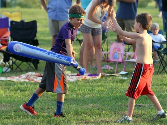 Children play in a field during the 35th annual Spittoono Festival in Central.