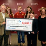 """Pearl River Valley Electric Power Association's Member Services Manager Kurt Brautigam, second from left, presents the """"Big Check"""" to JCJC student scholarship representatives, in back from left, Caitlyn Oliphant, Malachi Crabtree and Anna Wilks. They represent the 46 JCJC scholarship recipients through PRVEPA's """"Round Up for Education Scholar's Program.""""  Also pictured are JCJC President Jesse Smith; Theresa Erickson, executive director of the Greater PineBelt Community Foundation;  and Finee' Ruffin, JCJC vice president of marketing and recruiting."""
