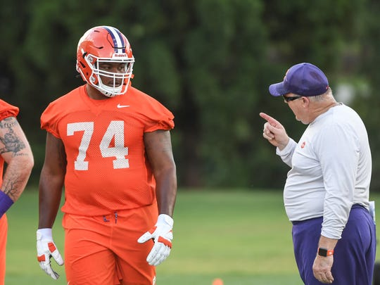 Clemson offensive line coach Robbie Caldwell, right,