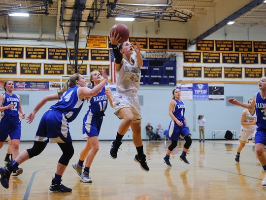 Essex's Rachel Botala (42) leaps for a lay up during