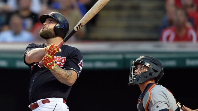Cleveland Indians first baseman Mike Napoli (26) hits an RBI double during the first inning against the Detroit Tigers at Progressive Field.