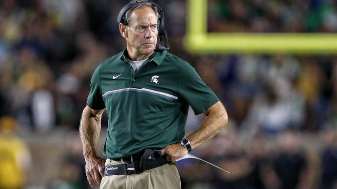 Sep 17, 2016; South Bend, IN, USA;  Michigan State Spartans head coach Mark Dantonio stands on the field during the first half a game against the Notre Dame Fighting Irish  at Notre Dame Stadium. Mandatory Credit: Mike Carter-USA TODAY Sports ORG XMIT: USATSI-270032 ORIG FILE ID:  20160917_gav_bc2_169.jpg