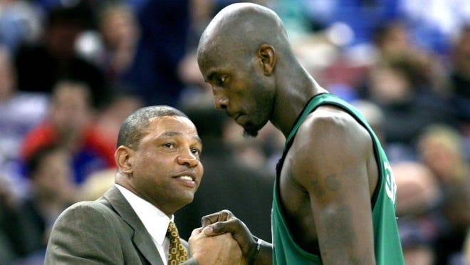 Boston Celtics coach Doc Rivers, left, and forward Kevin Garnett shake hands as Garnett leaves the game in the closing moments of an NBA basketball game against the Sacramento Kings in Sacramento, Calif., Wednesday, Dec. 26, 2007. The Celtics won 89-69.