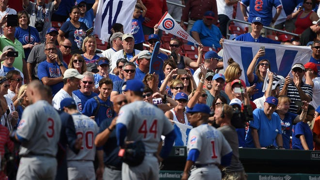 St. Louis, MO, USA; Chicago Cubs fans celebrate after the Cubs defeated the St. Louis Cardinals 7-0 at Busch Stadium.