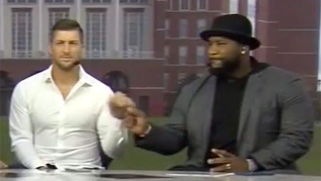 "Tim Tebow, left, and Marcus Spears are analysts on ""SEC Nation."""