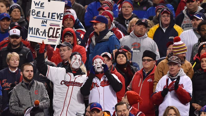 Cleveland Indians fans hold up a sign against the Chicago Cubs in the 6th inning in game two of the 2016 World Series at Progressive Field.