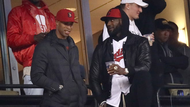 Richard Jefferson #24 and LeBron James #23 of the Cleveland Cavaliers attend Game Two of the 2016 World Series between the Chicago Cubs and the Cleveland Indians at Progressive Field on October 26, 2016 in Cleveland, Ohio.