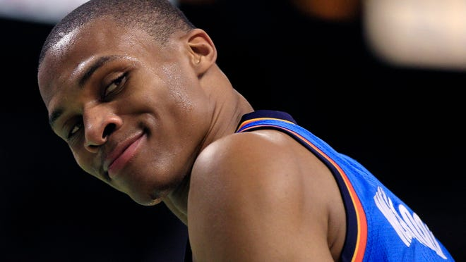 Oklahoma City Thunder guard Russell Westbrook looks back and smiles at Boston Celtics fans that taunted him during the second half of their NBA basketball game in Boston, Friday, Nov. 19, 2010.  Westbrook scored 31 point as the Thunder beat the Celtics 89-84.