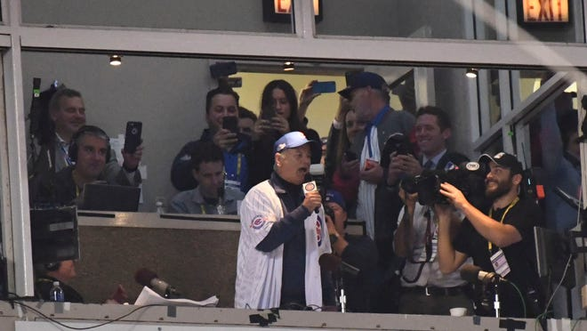 Oct 28, 2016; Chicago, IL, USA; American comedian Bill Murray sings Take me out to the ballgame during the seventh inning in game three of the 2016 World Series between the Chicago Cubs and the Cleveland Indians at Wrigley Field. Mandatory Credit: Tommy Gilligan-USA TODAY Sports ORG XMIT: USATSI-348580 ORIG FILE ID:  20161028_kkt_gb3_146.jpg