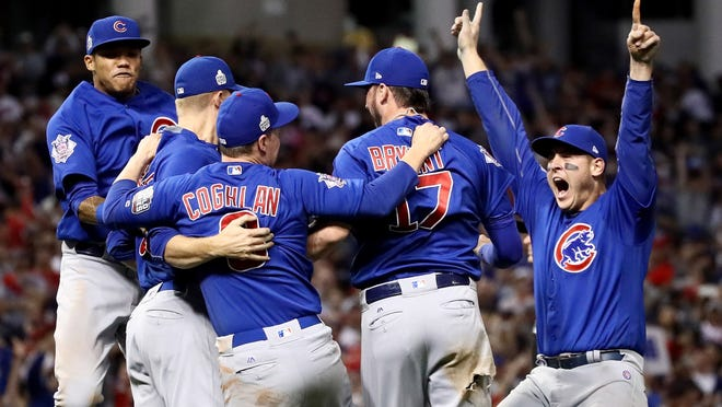 The Chicago Cubs celebrate after winning 8-7 against the Cleveland Indians in Game Seven of the 2016 World Series at Progressive Field on November 2, 2016 in Cleveland, Ohio. The Cubs win their first World Series in 108 years.