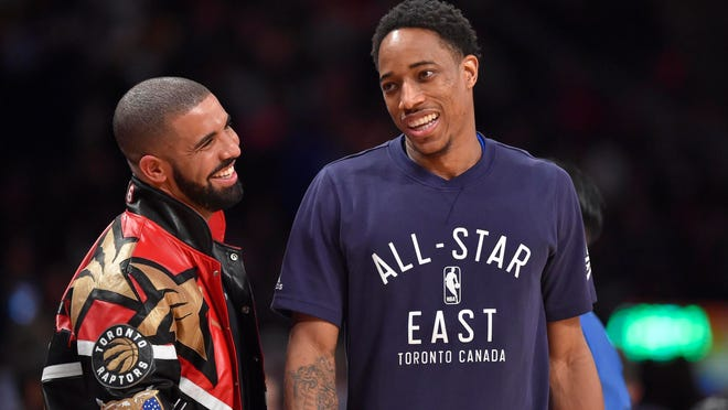 Eastern Conference guard DeMar DeRozan of the Toronto Raptors (right) talks with Drake in the second half during the NBA All Star Game at Air Canada Centre.