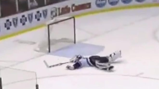 Ryan Miller went all out to make this save.