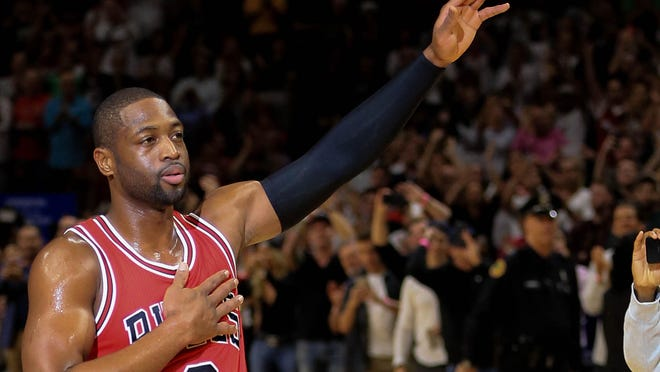 Dwyane Wade #3 of the Chicago Bulls waves to the crowd during the first quarter of the game against the Miami Heat at American Airlines Arena on November 10, 2016 in Miami, Florida.