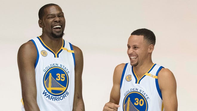 September 26, 2016; Oakland, CA, USA; Golden State Warriors forward Kevin Durant (35) and guard Stephen Curry (30) laugh during media day at the Warriors Practice Facility. Mandatory Credit: Kyle Terada-USA TODAY Sports ORG XMIT: USATSI-326224 ORIG FILE ID:  20160926_kkt_st3_004.jpg