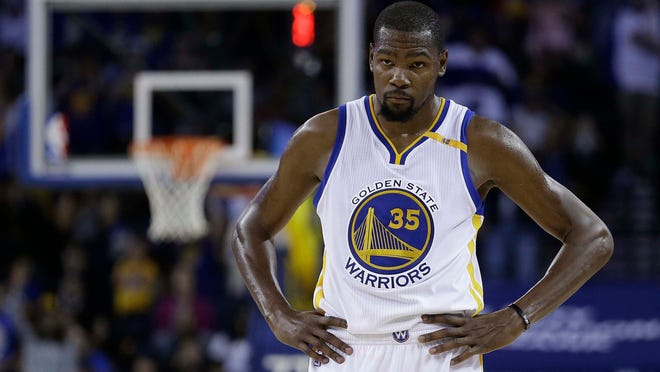 Golden State Warriors' Kevin Durant waits during a timeout in the second half of the team's preseason NBA basketball game against the Portland Trail Blazers on Friday, Oct. 21, 2016, in Oakland, Calif.
