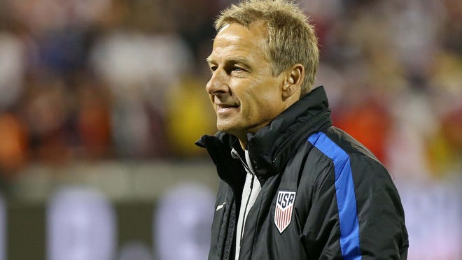 United States head coach Jurgen Klinsmann walks off the field after the United States' game against New Zealand at RFK Stadium. The game ended in a 1-1 tie.