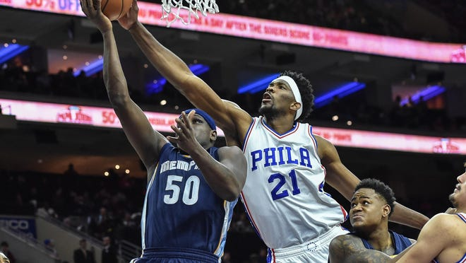 Philadelphia 76ers center Joel Embiid (21) blocks a shot by Memphis Grizzlies forward Zach Randolph (50) during the first quarter of the game at the Wells Fargo Center.