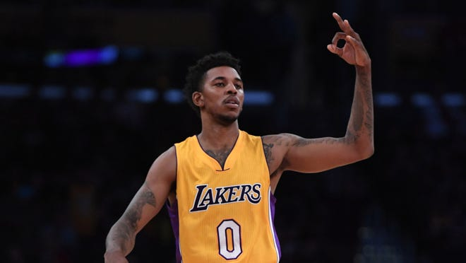 Los Angeles Lakers guard Nick Young (0) gestures after a Lakers three-point basket against the Brooklyn Nets during a NBA basketball game at Staples Center.