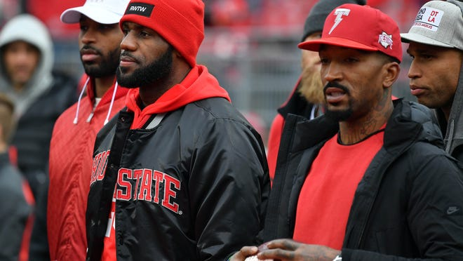 J.R. Smith and Lebron James of the Cleveland Cavaliers are seen on the field prior to the game between the Michigan Wolverines and Ohio State Buckeyes at Ohio Stadium on November 26, 2016 in Columbus, Ohio.