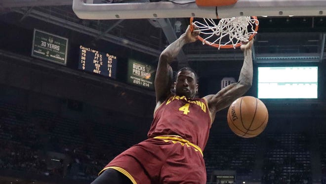 Cleveland Cavaliers' Iman Shumpert dunks during the first half of an NBA basketball game against the Milwaukee Bucks Tuesday, Nov. 29, 2016, in Milwaukee. (AP Photo/Morry Gash) ORG XMIT: WIMG109