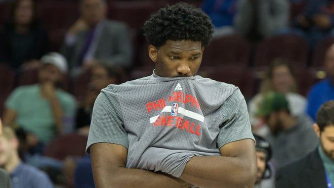 Philadelphia 76ers center Joel Embiid (21) stands by during a game delay against the Sacramento Kings at the Wells Fargo Center.