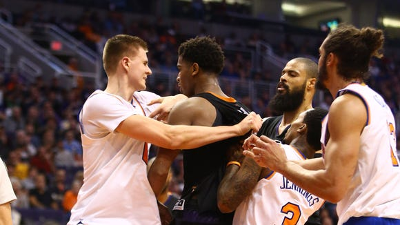 Dec 13, 2016; Phoenix, AZ, USA; New York Knicks forward Kristaps Porzingis (left) pushes Phoenix Suns forward Marquese Chriss as they fight in the third quarter at Talking Stick Resort Arena. Mandatory Credit: Mark J. Rebilas-USA TODAY Sports ORG XMIT: USATSI-324100 ORIG FILE ID:  20161213_mjr_su5_022.JPG