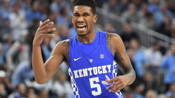 Kentucky Wildcats guard Malik Monk (5) gestures towards a teammate during a game against the North Carolina Tar Heels at T-Mobile Arena.