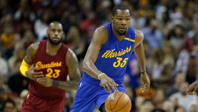 Golden State Warriors forward Kevin Durant (35) brings the ball up court against the Cleveland Cavaliers at Quicken Loans Arena.