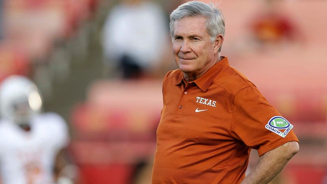 """University of Texas football head coach Mack Brown watching his team warm up before an NCAA college football game against Iowa State, in Ames, Iowa. Former Texas coach Brown will serve as a studio analyst for college football games on ABC. Brown stepped down in December after 16 years with the Longhorns, winning the national title after the 2005 season. Brown will appear on """"College Football Countdown"""" and offer pregame, halftime and postgame commentary for the games on ABC, including """"Saturday Night Football."""""""