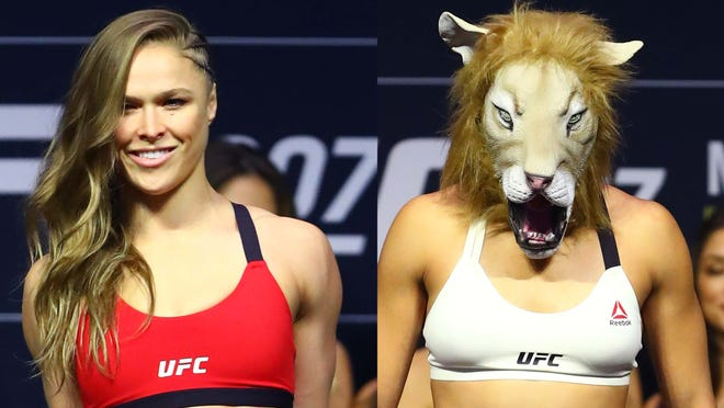 Amanda Nunes wears a tiger mask during weigh ins for UFC 207 at T Mobile Arena.