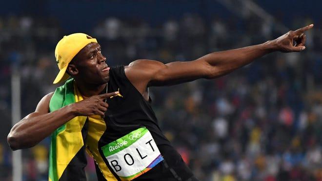 Usain Bolt (JAM) celebrates after winning the men's 100m final in the Rio 2016 Summer Olympic Games at Estadio Olimpico Joao Havelange.